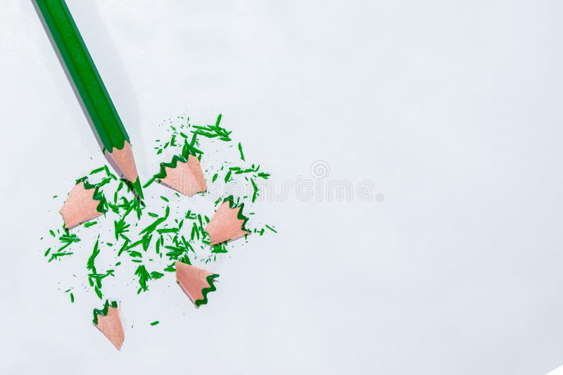 Green pencil after the sharpener royalty free stock photo