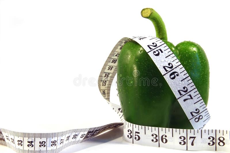 Green pepper and measurement tape stock photo