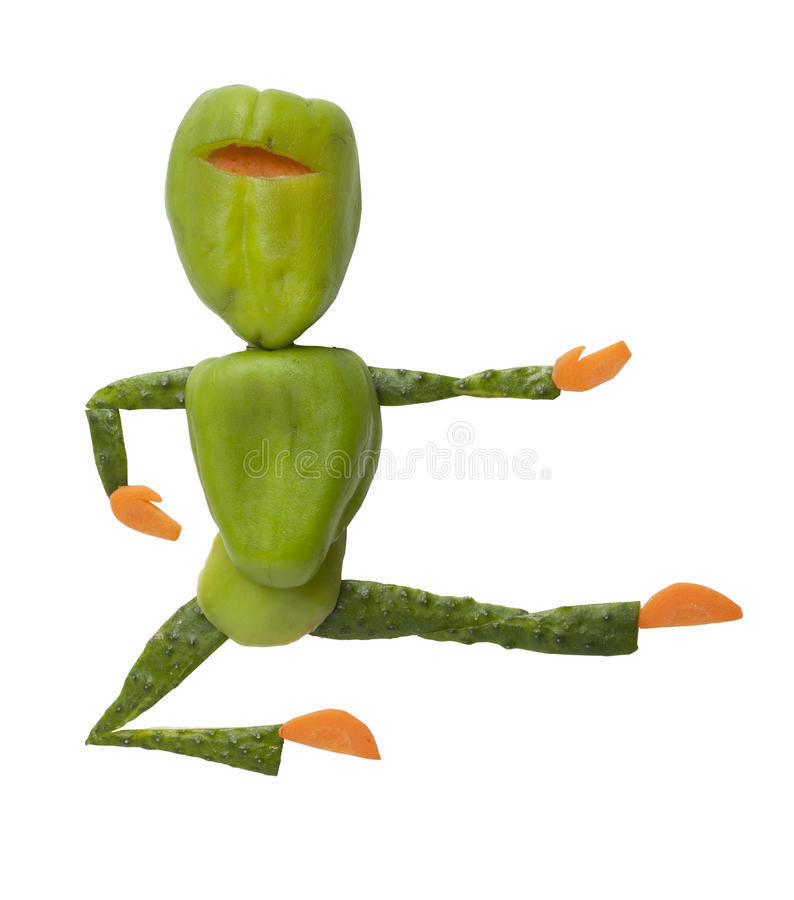 Green pepper ninja kicks with leg in jump stock images