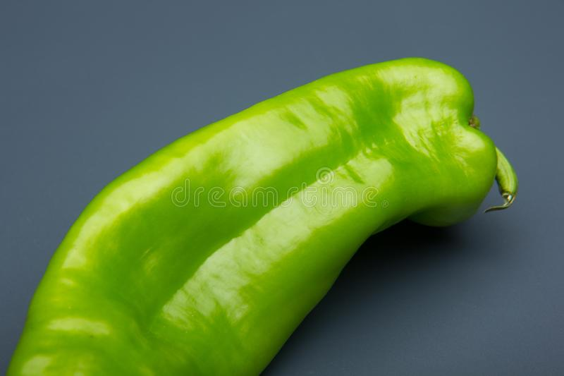 Fresh pepper, fresh from the garden. The green pepper, still needs to mature in the bush, but it is perfectly consumable and can be eaten. The red pepper, is royalty free stock images