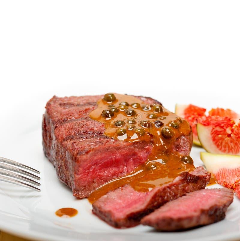 Green peppercorn beef filet mignon. Beef filet mignon with green peppercorn creamy sauce ou poivre vert royalty free stock photo