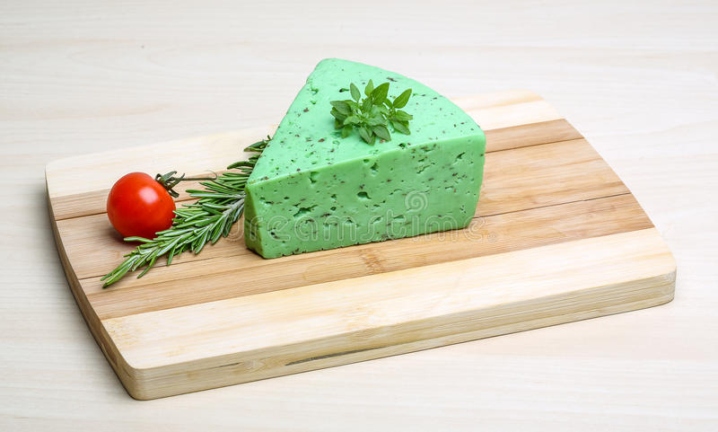 Green pesto cheese and basil leaves royalty free stock image