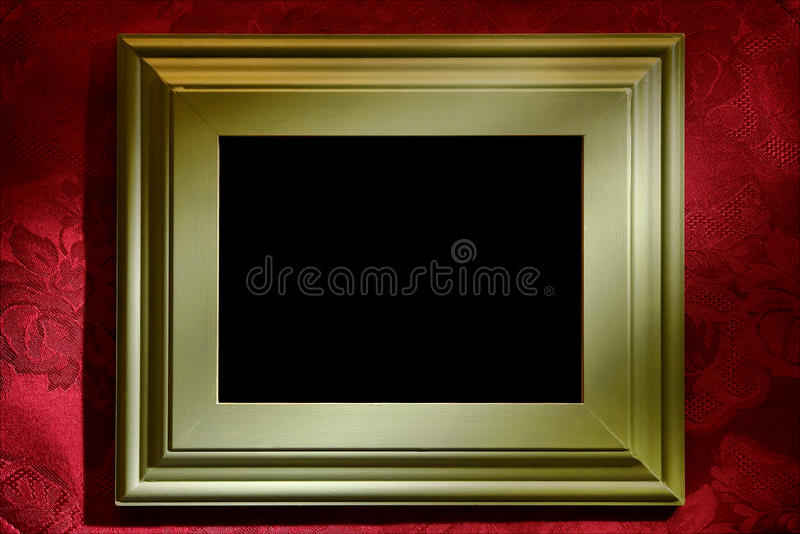 Green Picture Frame over Red Wallpaper Background stock photo