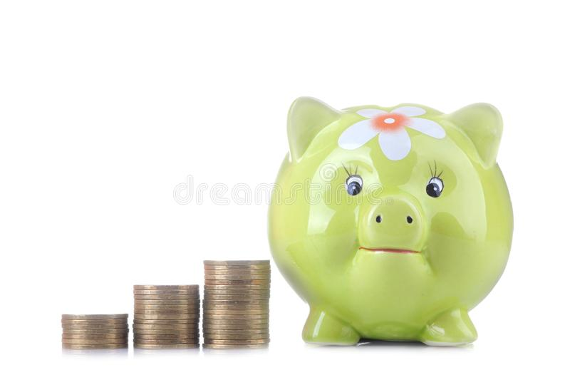 Green pig moneybox and money on white isolated background. Finance, savings, money royalty free stock photography