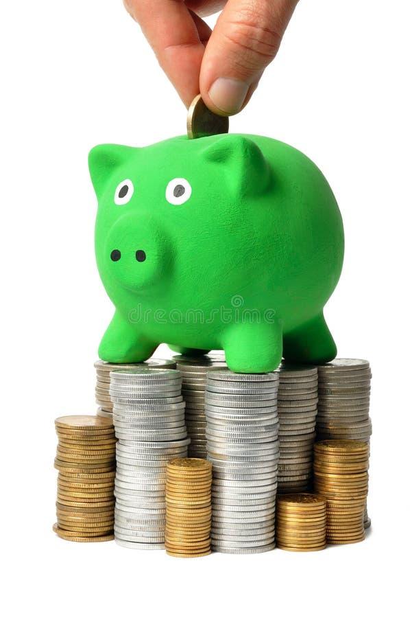 Green Piggy Bank and Coins royalty free stock photos