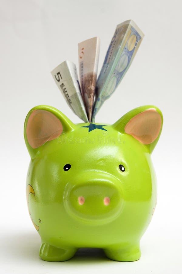 Green Piggy Bank And Money Royalty Free Stock Photos