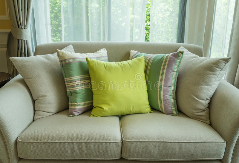 Green pillows on modern sofa. In living room royalty free stock image