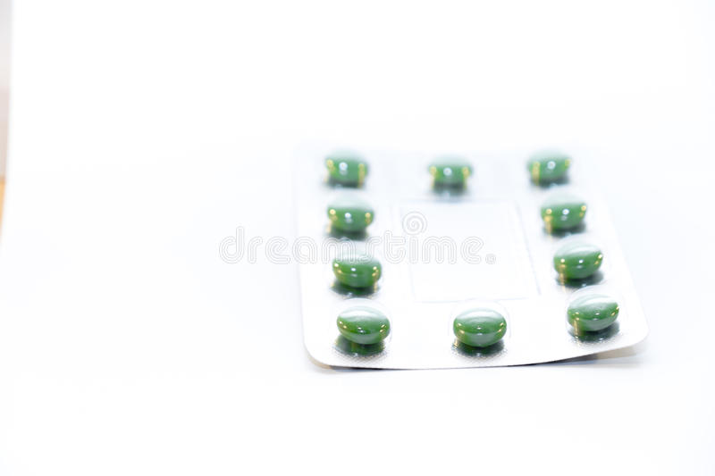 Download Green pills in blister stock photo. Image of headache - 83706550