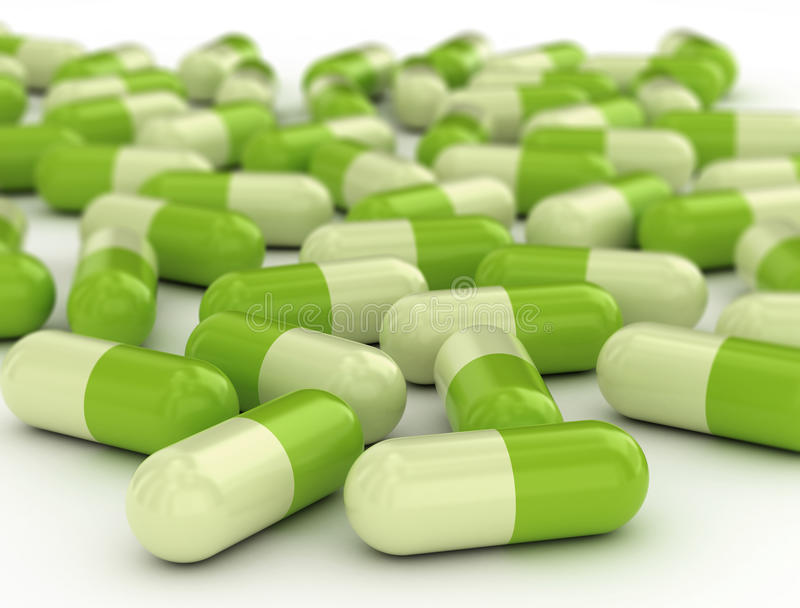 Green pills stock photography