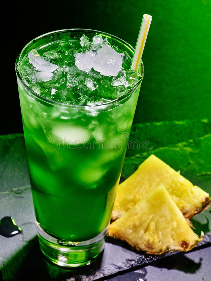 Green pineapple cocktail on dark background 51 stock photo for Cocktail 51