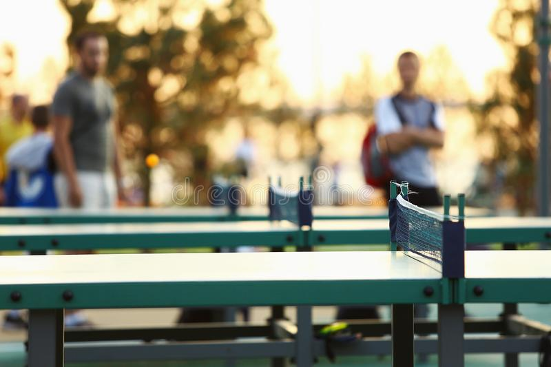Green ping pong table outdoors. Table tennis equipment in park stock photography