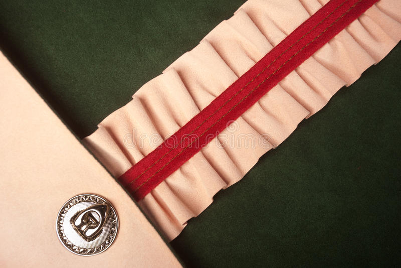 Green, pink and red leather. Texture sewing - vibrant colors stock photo