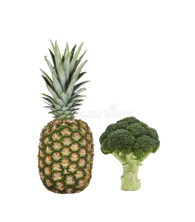 Green pinneaple and broccoli,. Two ingredients for detox your body royalty free stock image