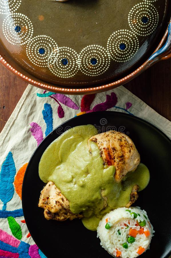 Green pipian pipian or mole verde, traditional Mexican food. Sauce made from pumpkin seeds and chilis, traditionally from the states of Puebla, Tlaxcala and stock photo