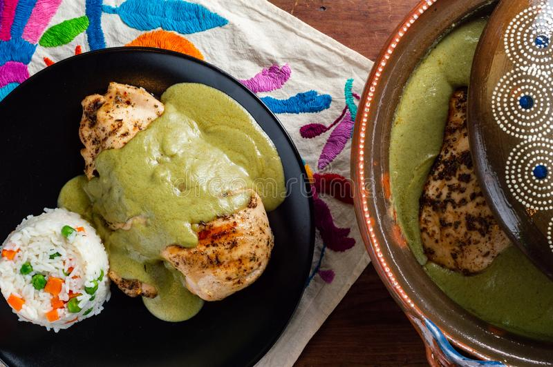 Green pipian pipian or mole verde, traditional Mexican food. Sauce made from pumpkin seeds and chilis, traditionally from the states of Puebla, Tlaxcala and stock photos