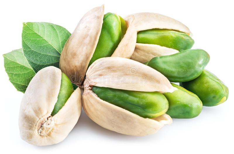 Green pistachio nuts with pistachio shell. royalty free stock image