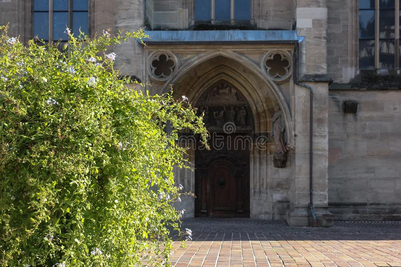 Green plant before historical church facade. In autumn south germany afternoone stock photography