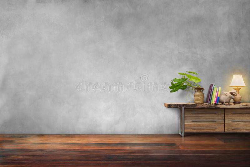 Green plants pottery vase on drawer wooden in empty room stock photography