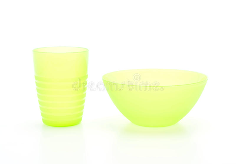 green plastic bowl and glass stock images