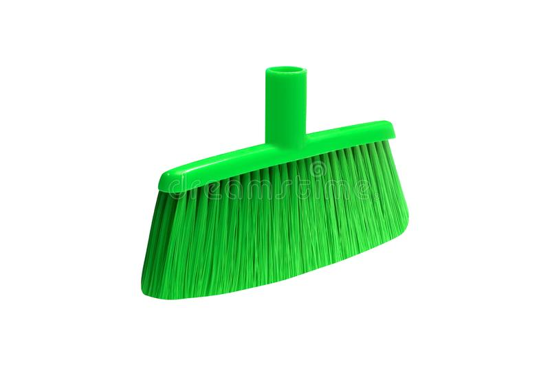 Green plastic broom. On white background royalty free stock photo
