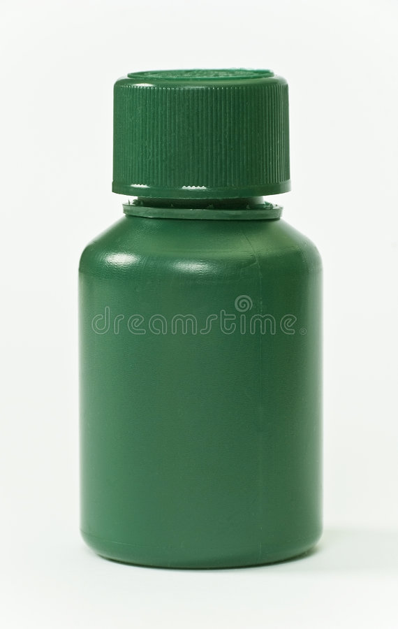Green plastic pills bottle royalty free stock photography