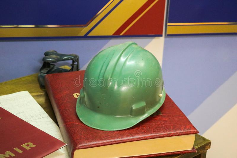 Green plastic safety helmet for the worker. Protective helmet to royalty free stock photos