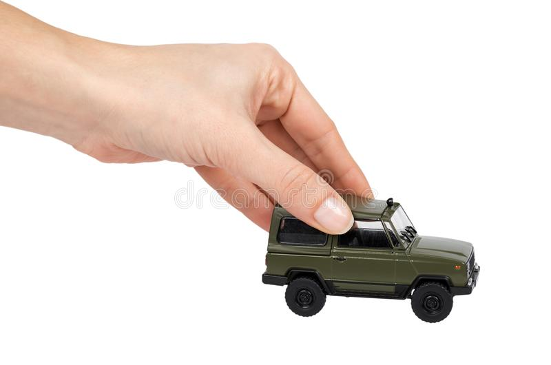 Green plastic toy SUV vehicle, offroad truck, military car, 4x4 auto in hand. Isolated on white background.  stock images