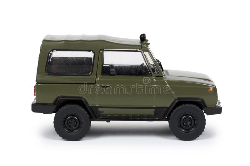 Green plastic toy SUV vehicle, offroad truck, military car, 4x4 auto. Isolated on white background.  stock images