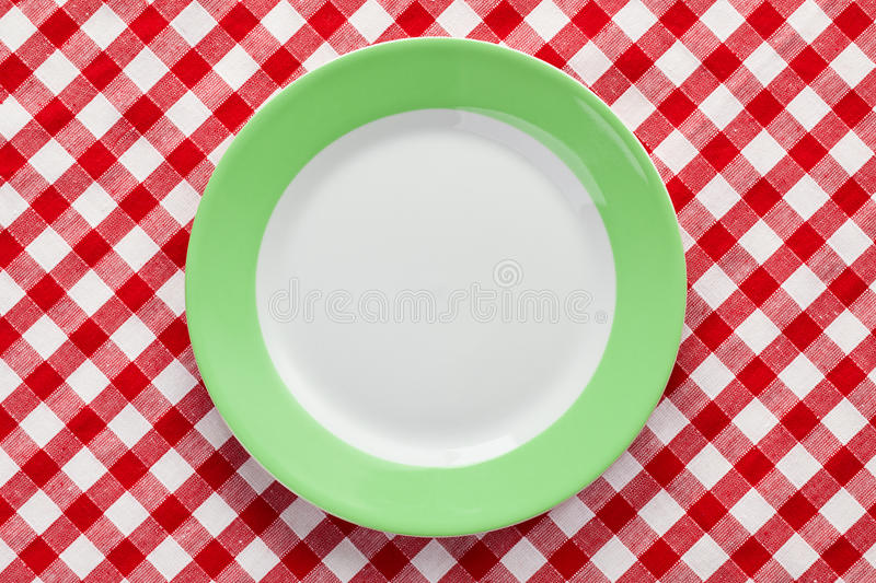 Download Green Plate On Checkered Tablecloth Stock Photo - Image: 17361230