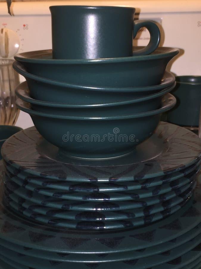 Green plates, bowls, and mug. royalty free stock photo