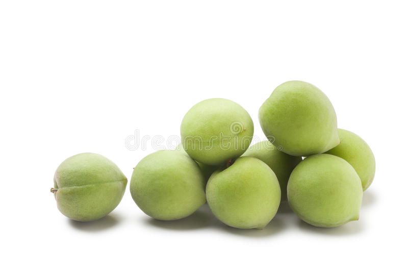 Green plum. Isolated on a white background royalty free stock photo