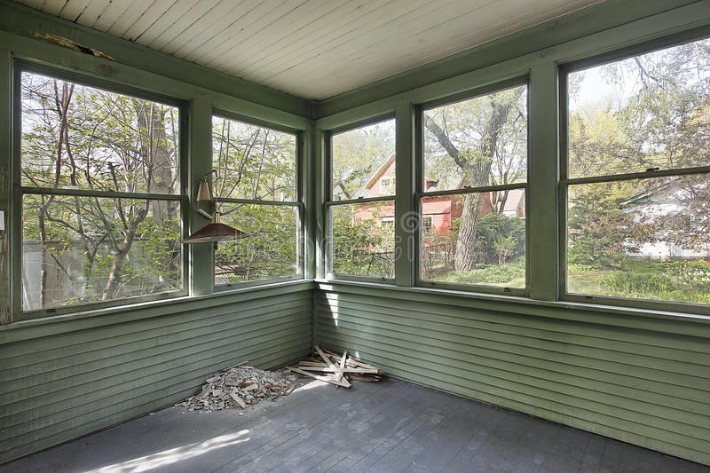 Green porch in old abandoned home royalty free stock photo