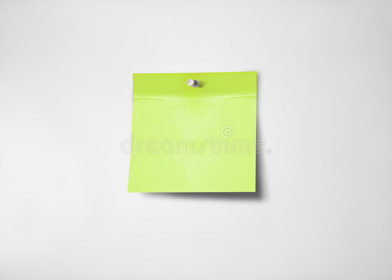 Green post-it note. Blank green-yellow adhesive post-it note stock photo