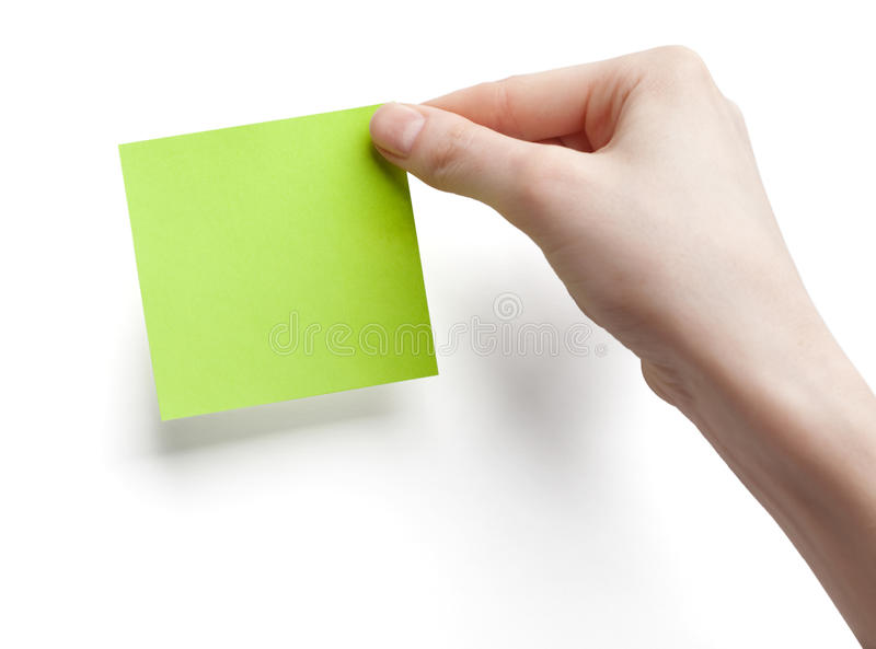 Green post-it note. With hand on white background stock images