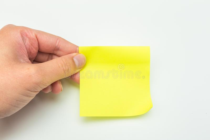 Green post-it note with hand on white background. Image stock photos