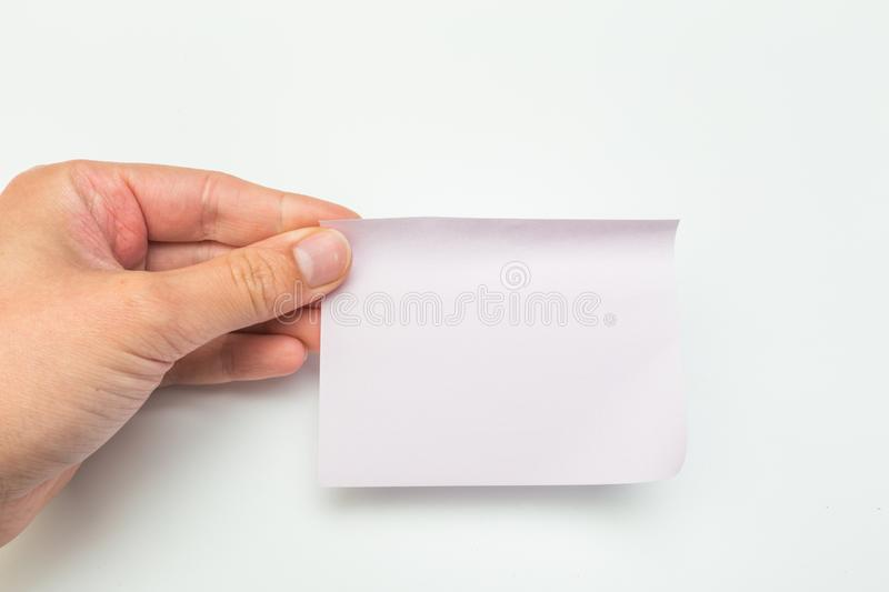Green post-it note with hand on white background. Image stock photo