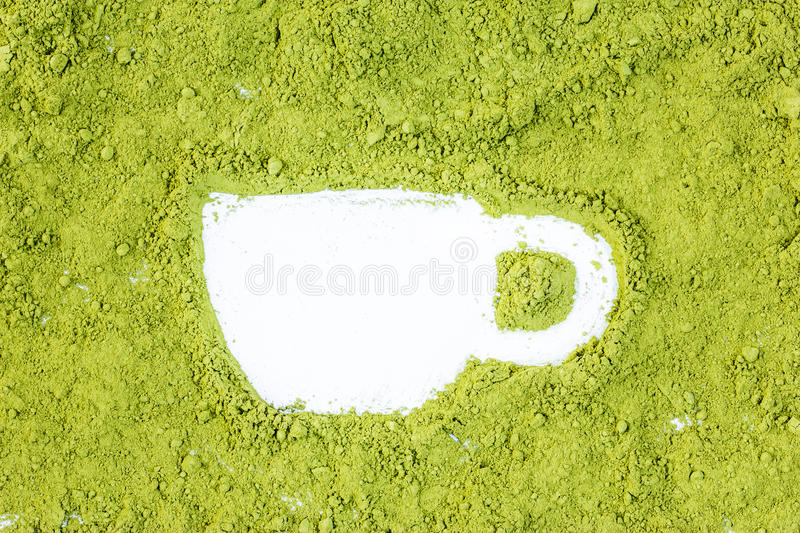Green powder forming cup shape surface close up royalty free stock photo