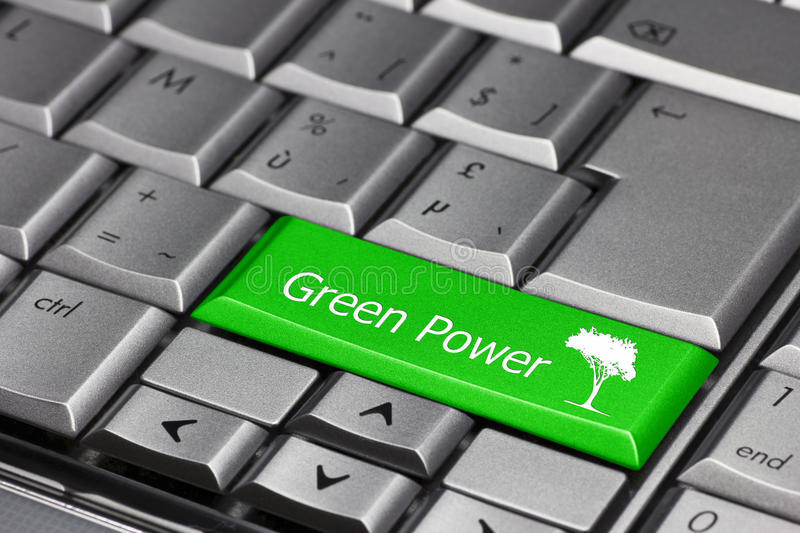 Green power on a keyboard key. A green key on a keyboard saying 'Green Power' and showing a tree. Using green power at home or in the company royalty free stock images
