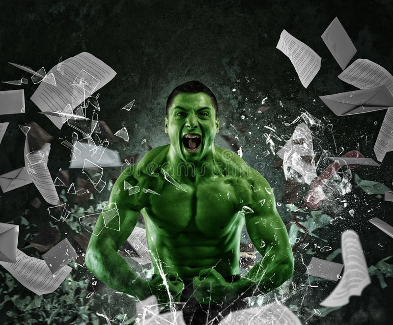 Green powerful muscular man. Screaming breaks a glass and throws sheets royalty free stock image