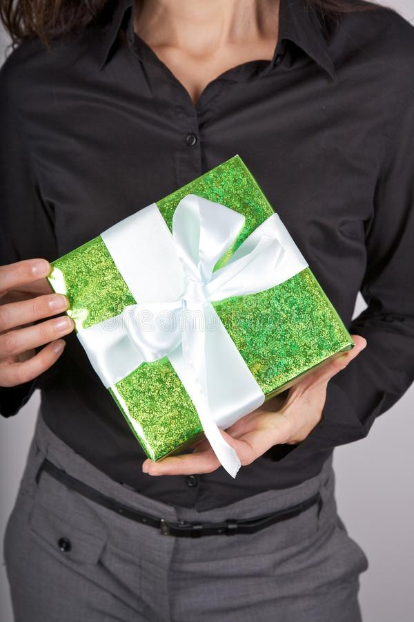 Green Present On Black Background Royalty Free Stock Photos