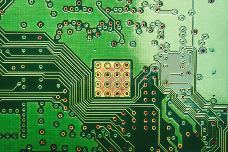 Green printed circuit boards with fine stripes for conveying and determining electrical pathways and various resistance values royalty free stock image