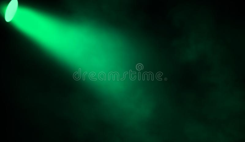 Green projector. Spotlight stage with smoke on black background. Perfect Spotlight stage . Projector on isolated black background.texture royalty free stock photos