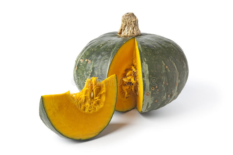 Green pumpkin with orange pulp. On white background stock image
