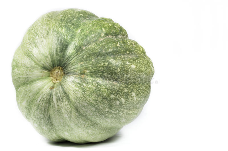 Green pumpkin on white background. Blank space to the right stock photo