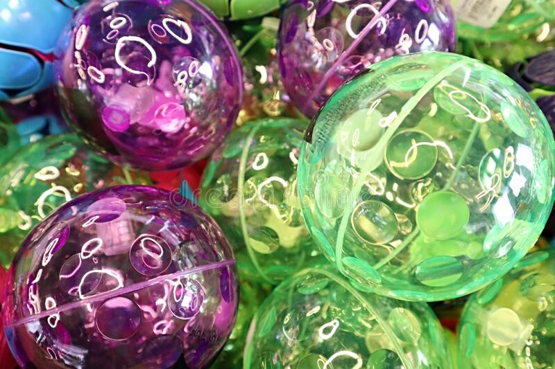 Green and purple bounce balls in a pile royalty free stock image