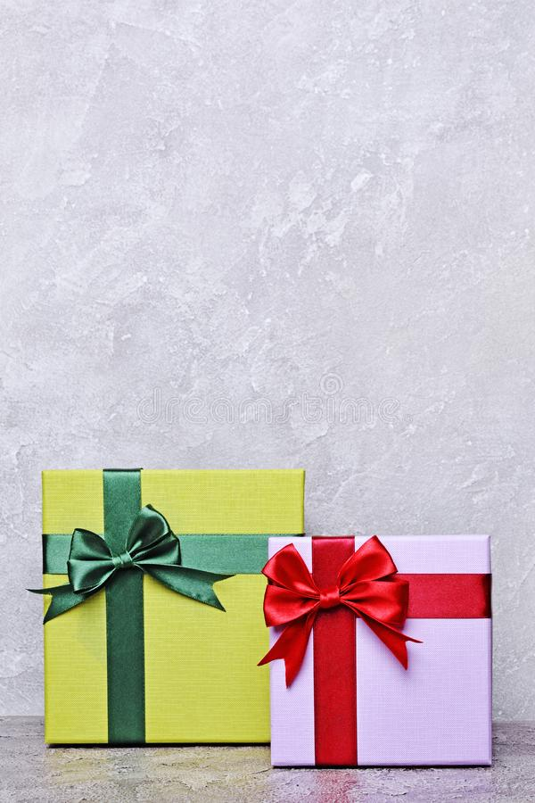 Green and purple classic gift box with red satin bow and copy space stock images