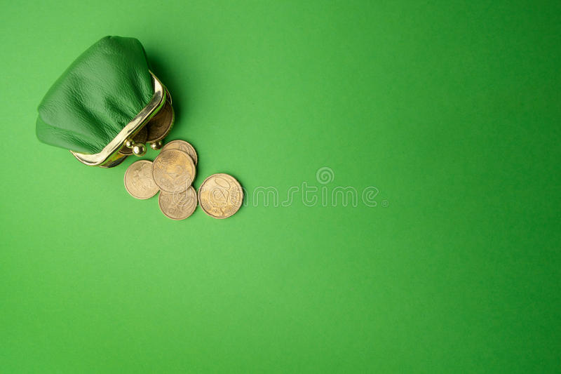 Green purse coin EURO on green background. Top view royalty free stock photography