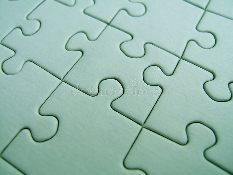 Green puzzle. Close-up stock photography