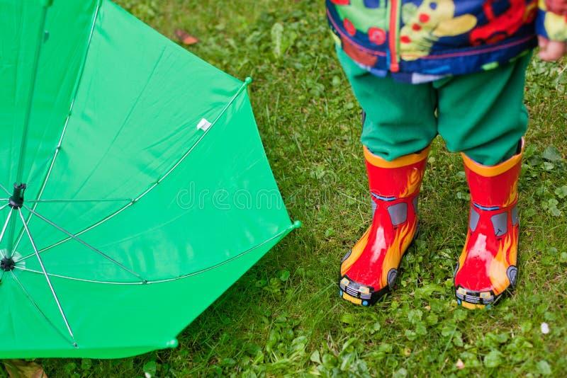 Download Green Rain Umbrella And Children Autumn Boots Stock Image - Image: 26671843