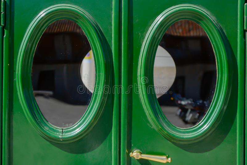 Green rear doors with oval windows of an old car stock images